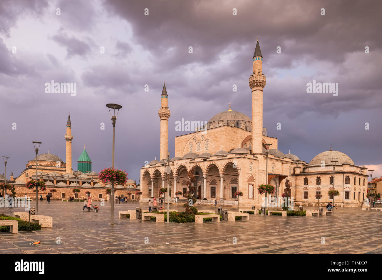 The central square of the old town of Konya with the Mevlana Museum on the background and Selimiye Mosque, Turkey - Stock Image