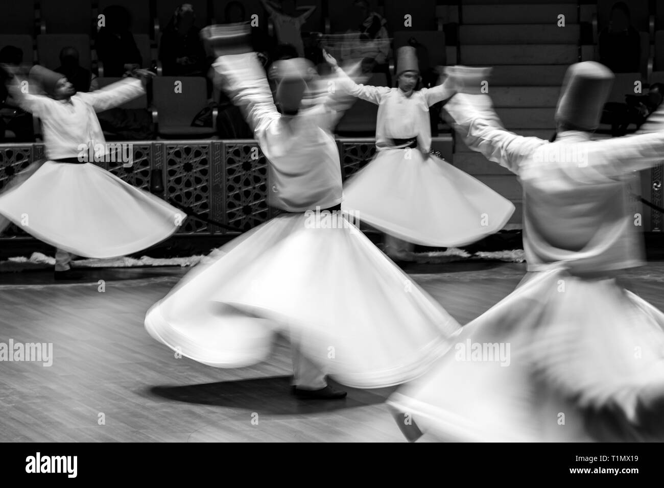 Unidentified whirling Dervishes or Semazen in Konya - Stock Image