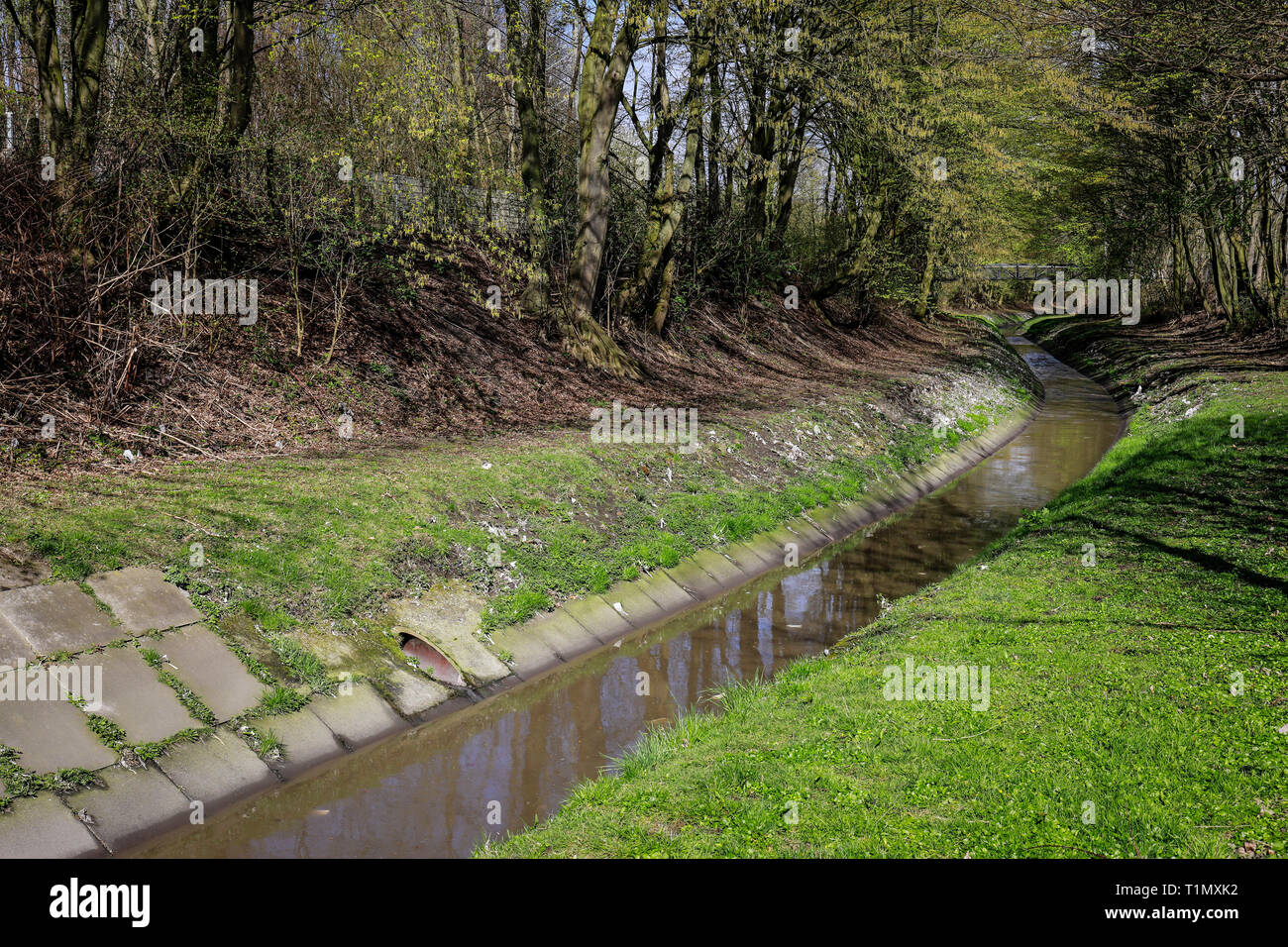Essen, North Rhine-Westphalia, Germany - The Berne is a small river that rises in the city of Essen and flows into the Emscher. The canalised Berne is Stock Photo