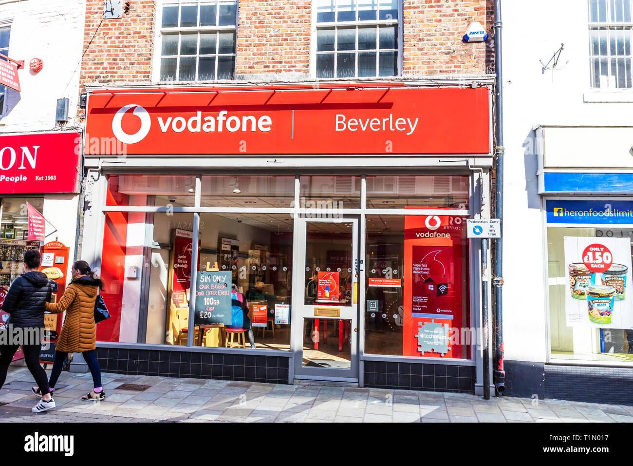 Vodafone Store, Vodafone mobile phone phones shop store sign building exterior name smartphone cities British chain brand Beverley UK stores shops Stock Photo