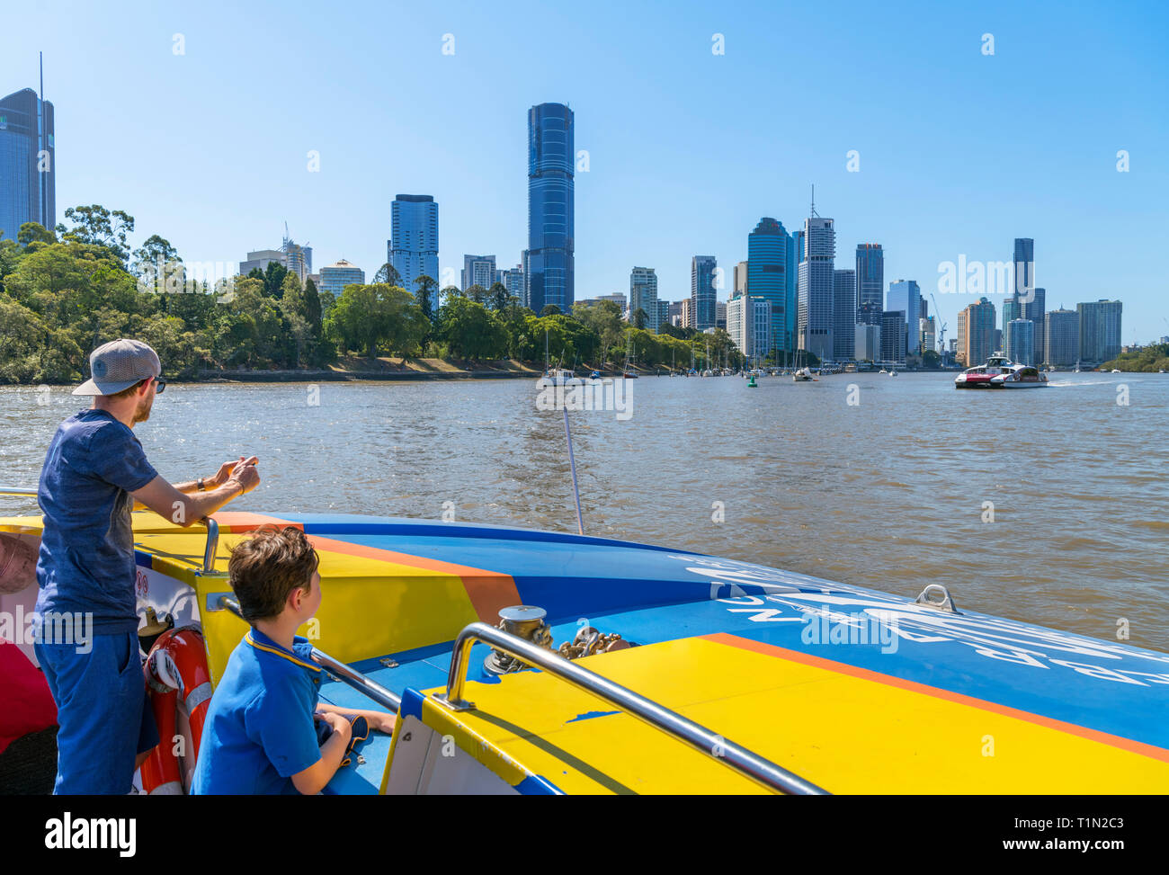 The downtown skyline from a CityCat ferry on the Brisbane River, Brisbane, Queensland, Australia - Stock Image