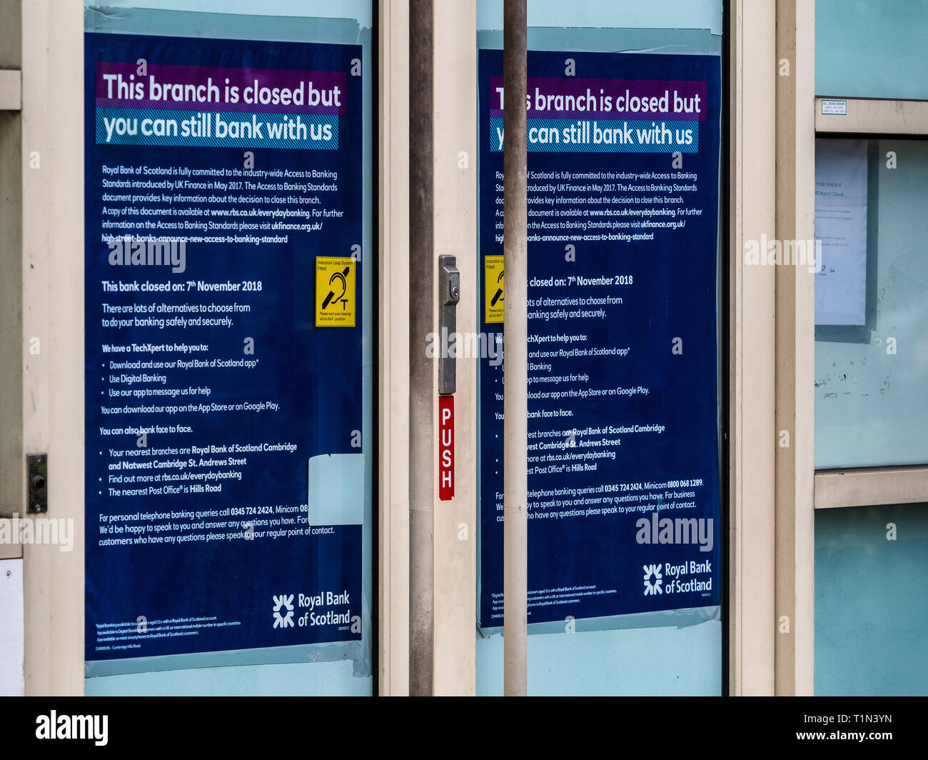 Closed RBS Branch in Cambridge - window signs detailing shutdown of an RBS branch in Hills Road Cambidge - Stock Image