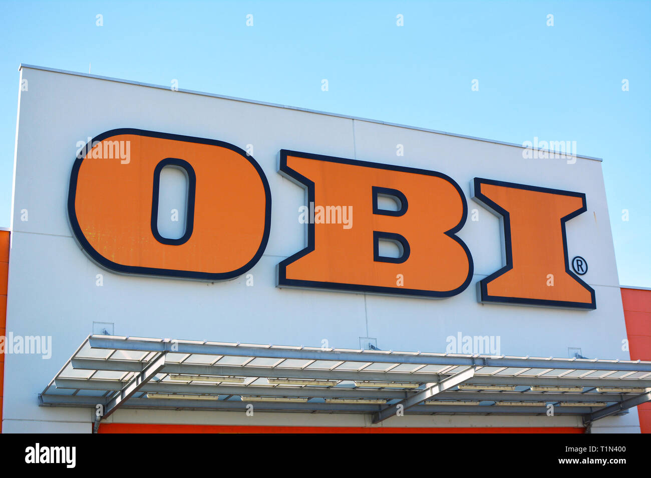 Store front with orange logo of German multinational home improvement and gardening supplies retailing company called OBI in Heidelberg, germany - Stock Image