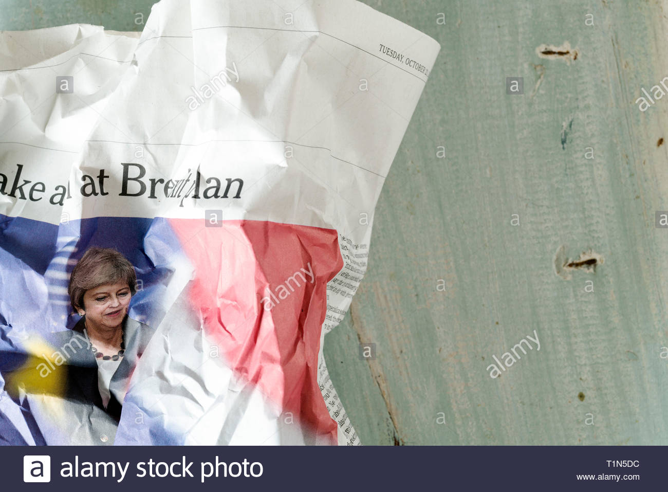 crumpled newspaper with portrait of English Prime Minister Theresa May - Stock Image