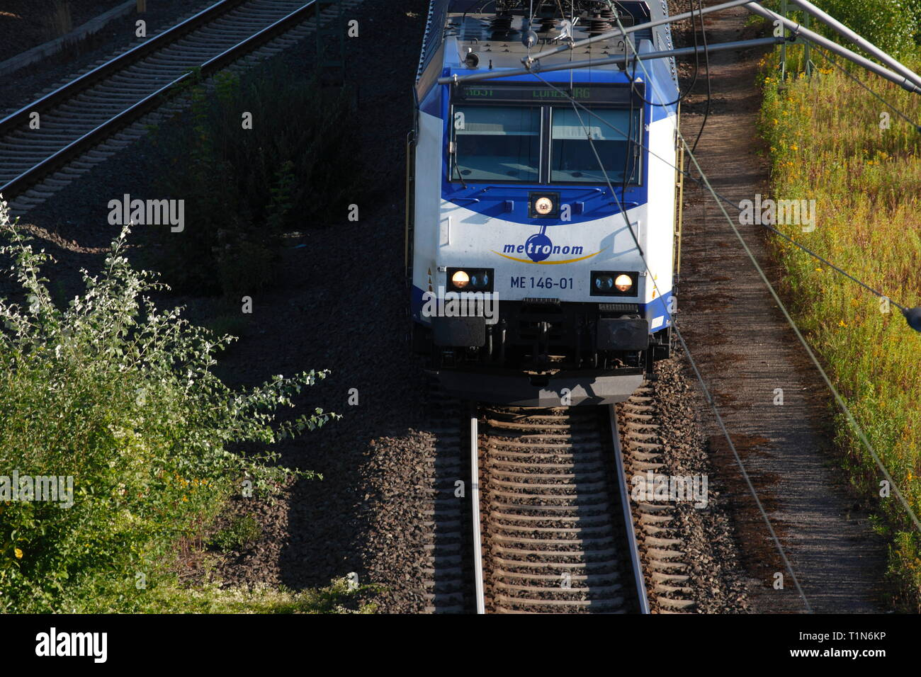 Railway with rails and commuter train Metronom, Harburg, Hamburg, Germany, Europe I Bahnanlage mit Schienen und Nahverkehrszug Metronom, Harburg, Hamb - Stock Image