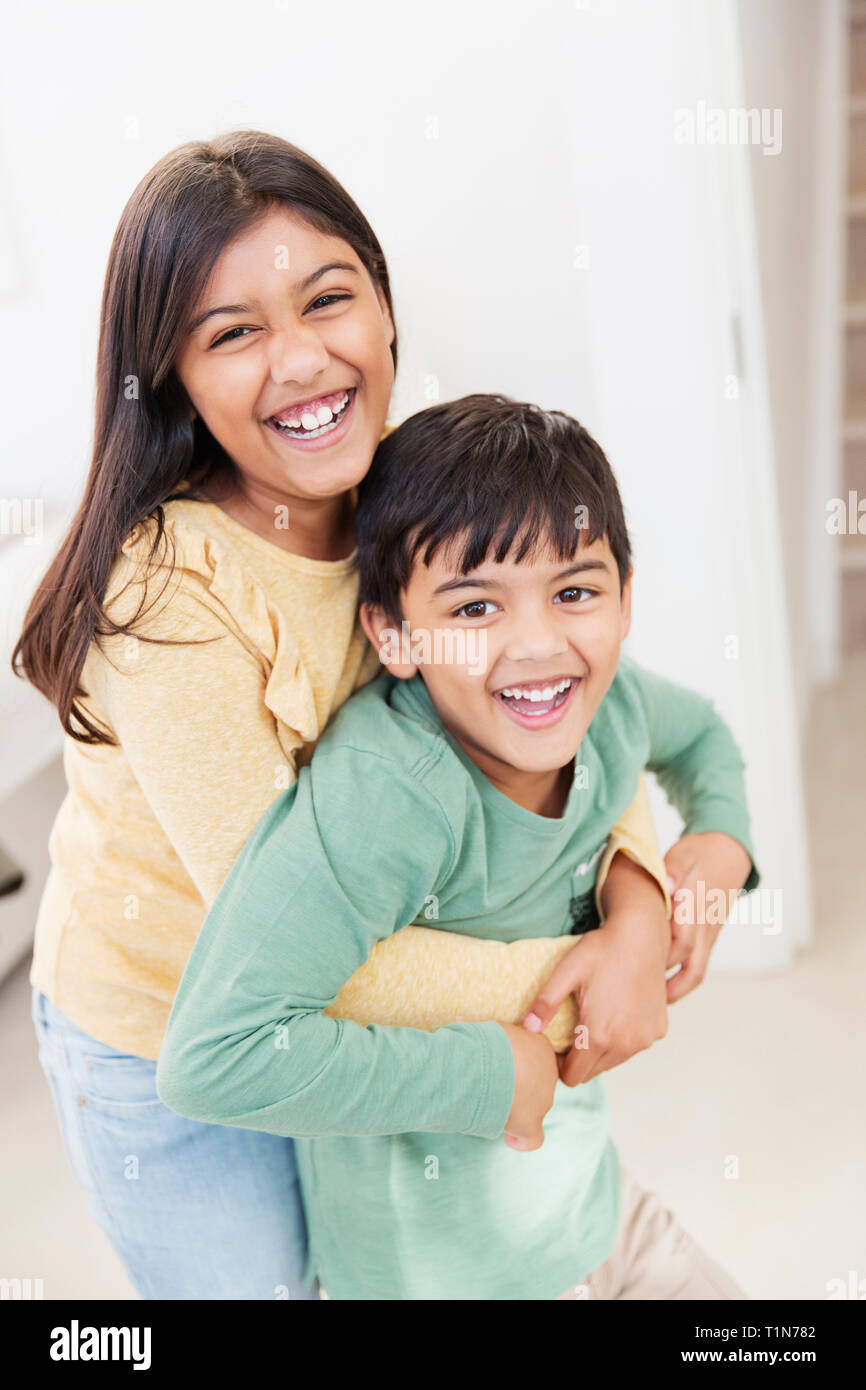 Portrait happy brother and sister Stock Photo