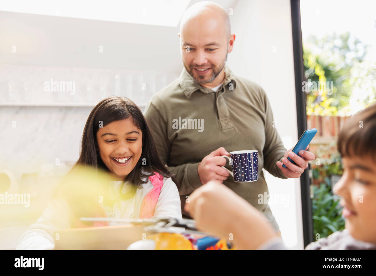 Father and daughter using digital tablet and smart phone Stock Photo