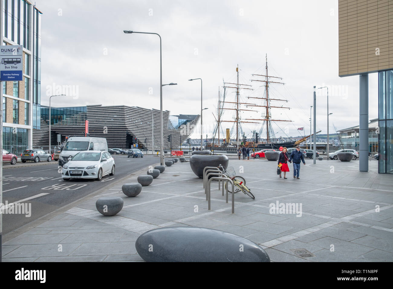 Dundee, Scotland, UK - March 22, 2019: Looking down Union St to the new V & A Museum on Riverside Esplanade where the masts of the ship RRS Discovery  Stock Photo