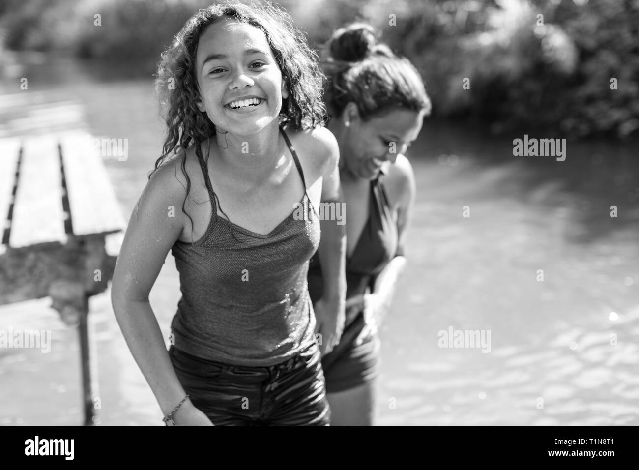 Portrait happy, carefree mother and daughter at river Stock Photo