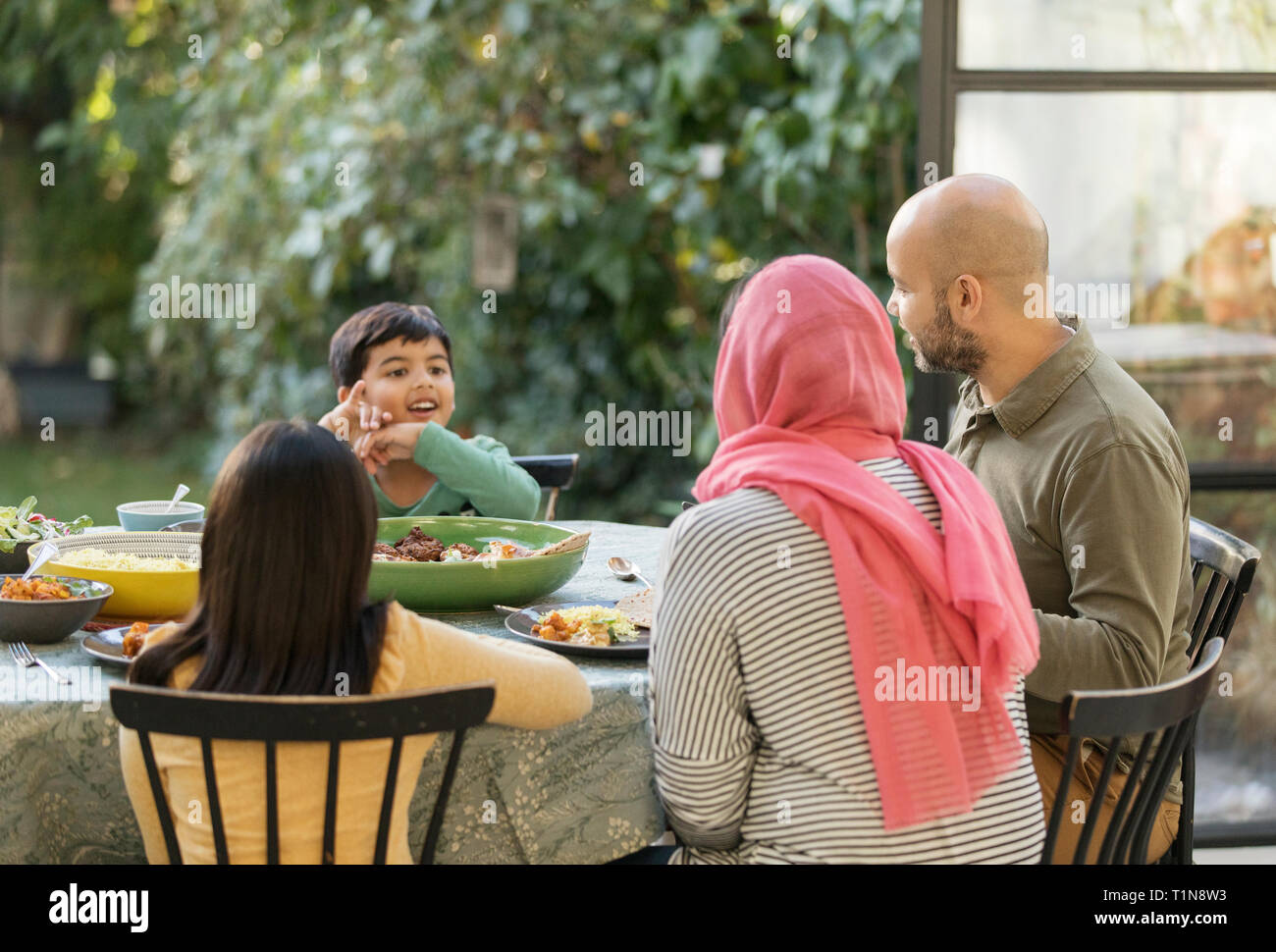 Family eating dinner at table Stock Photo