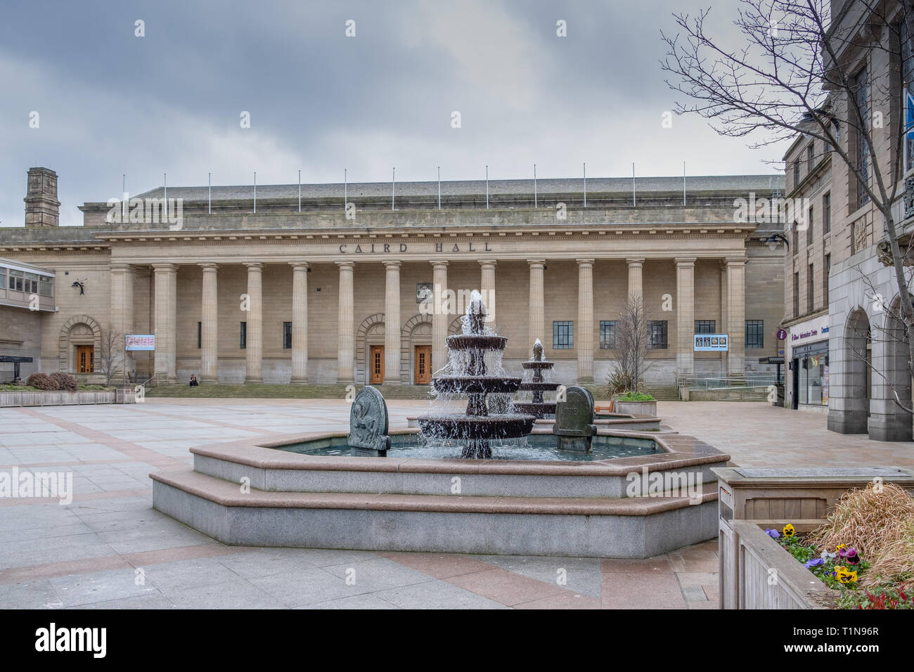 Dundee, Scotland, UK - March 22, 2019: Looking over the square past two fountains sits the impressive Caird Halls in the city centre of Dundee Scotlan - Stock Image