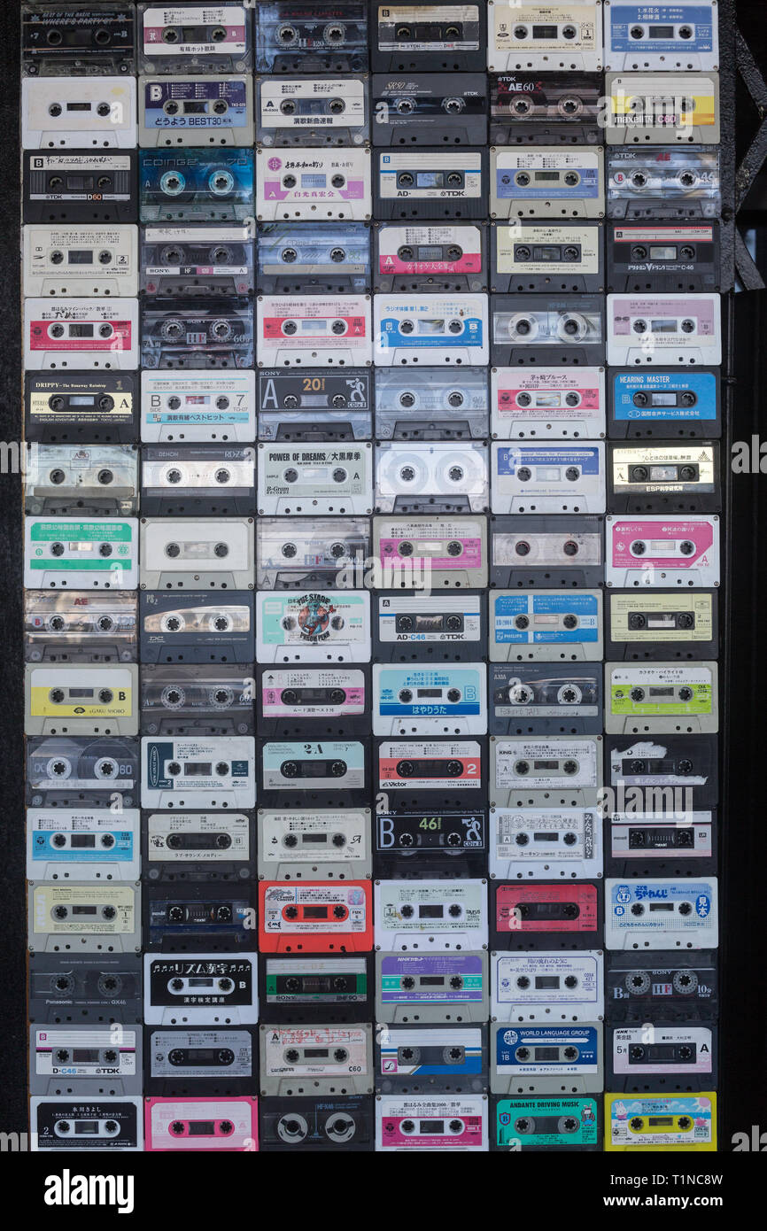 funny capture walking by the street in Phnom Penh, some old school music cassette stick together on a wall - Stock Image