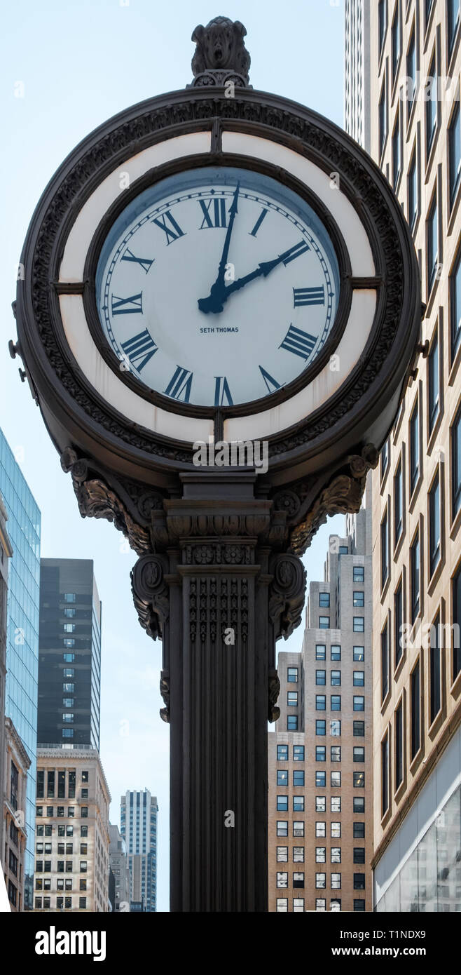 Close-up of sidewalk clock by  Seth Thomas at 522 Fifth Avenue & West 44th Street, Manhattan, New York City. March 2018 - Stock Image