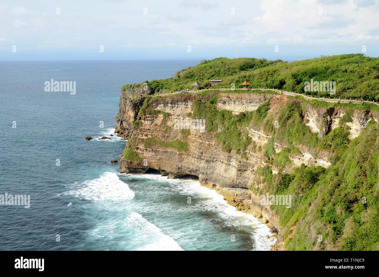 Pura Luhur Uluwatu temple in Bali, Indonesia with cliff with blue sky and sea Stock Photo