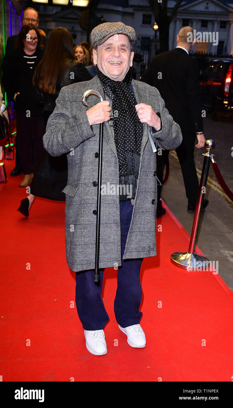 Sylvester McCoy arriving for the pre-premiere screening of Accidental Studio, the documentary telling the story of HandMade Films at Curzon Mayfair, London. - Stock Image
