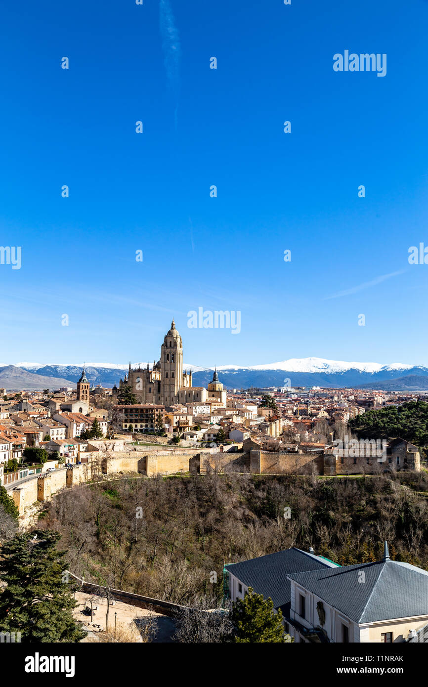 Segovia, Spain: view from Juan II tower in Winter time of the Alcazar of the old town of Segovia and the Cathedral with the snow capped Sierra de Guad Stock Photo