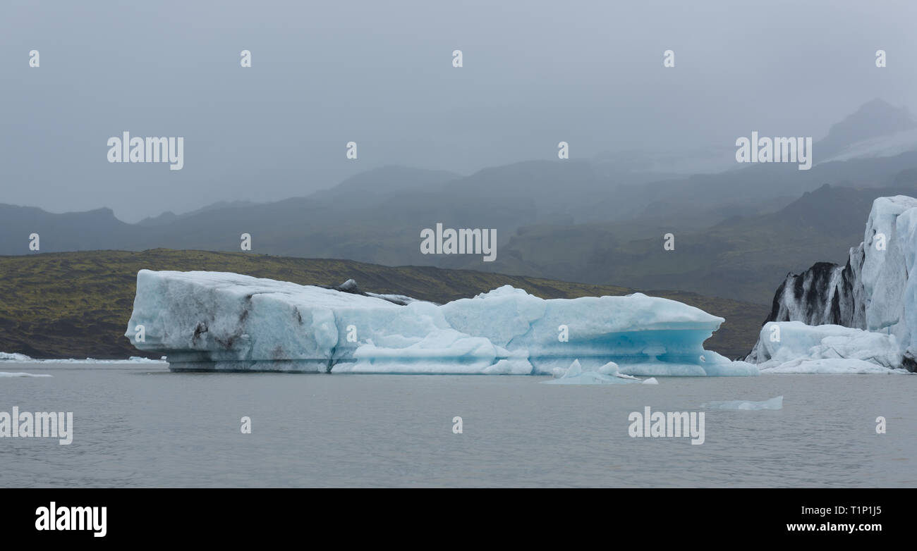 Beautiful view of icebergs in Jokulsarlon glacier lagoon, Iceland, global warming and climate change concept - Stock Image