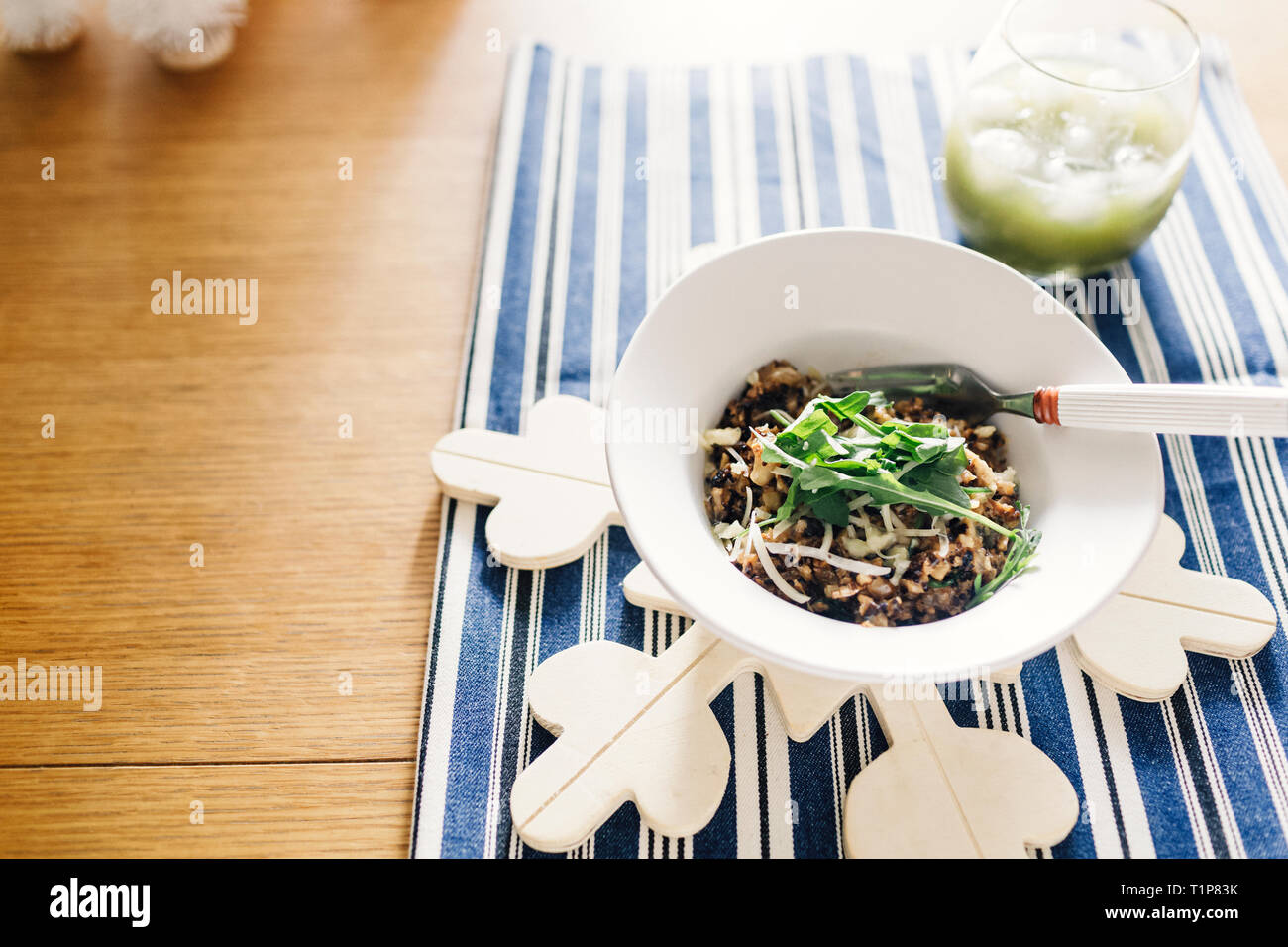 Overhead of risotto salad and green juice - Stock Image