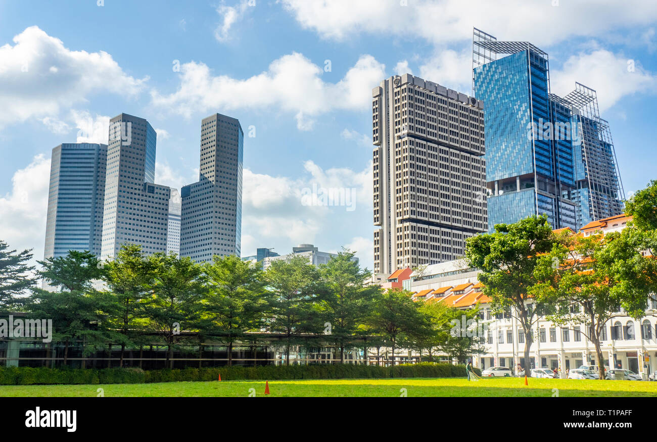 T1 T2 T3 office towers of Suntec City, Shaw Tower South Beach Tower and JW Marriott Hotel seen from Tan Quee Lan Field Singapore. - Stock Image