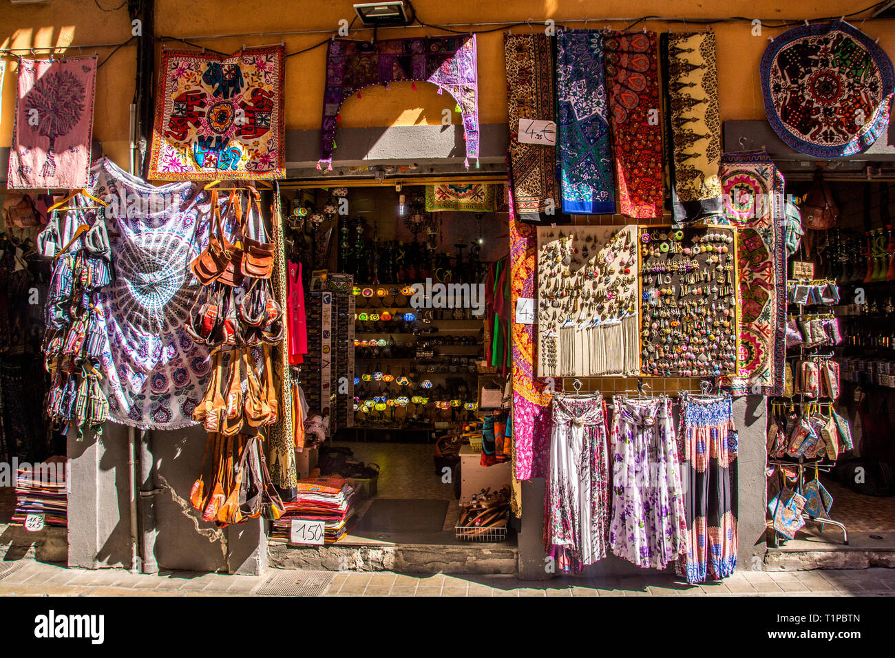 Venders selling a variety of clothing and other items; Granada, Spain. - Stock Image