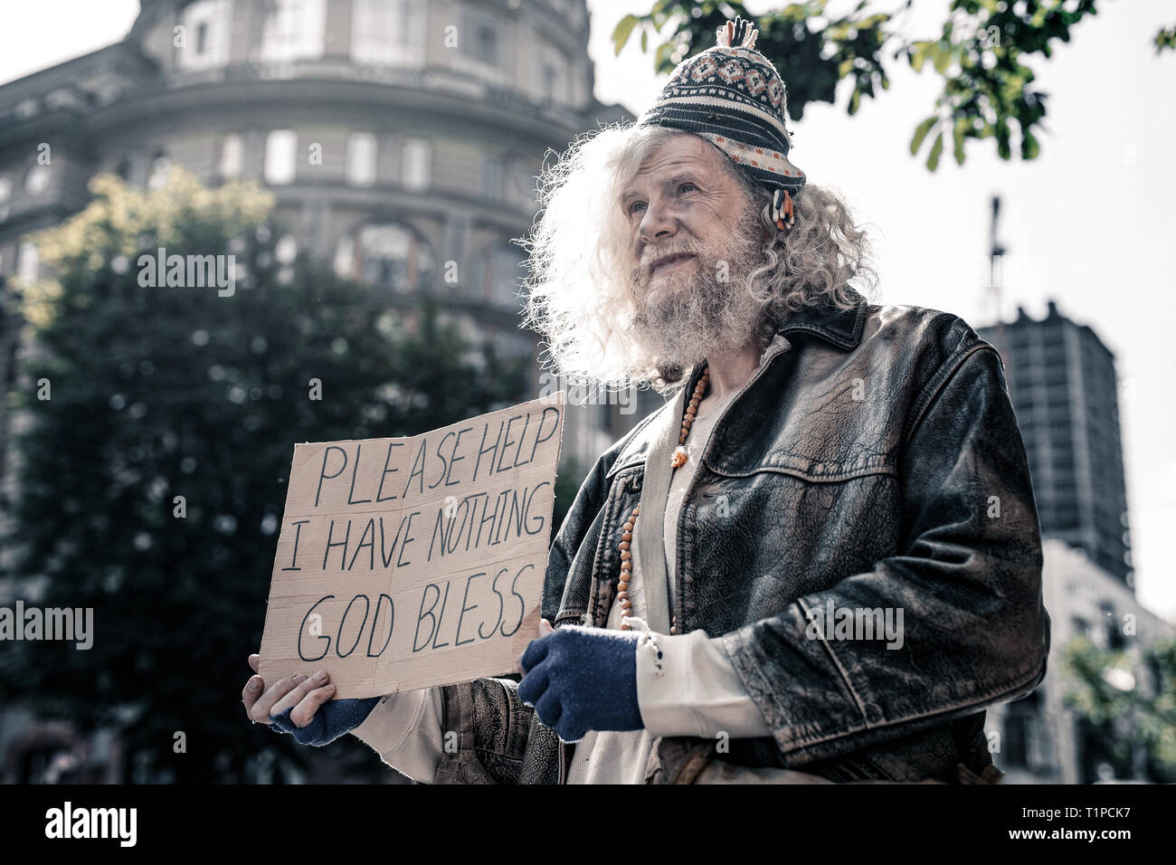 Poor distressed old man having nothing and living on the street - Stock Image
