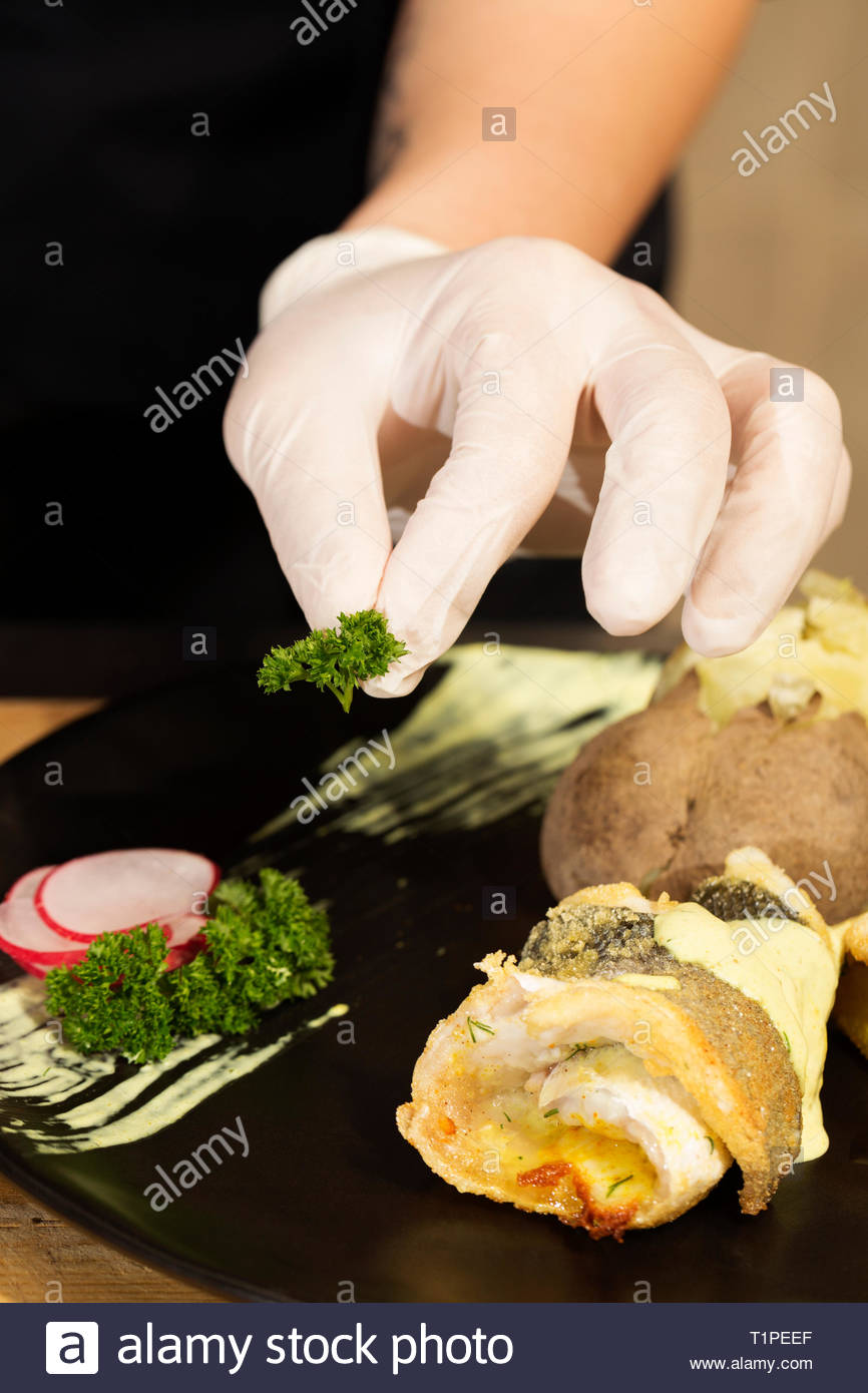 fillet of perch with mustard on pine nuts - Stock Image