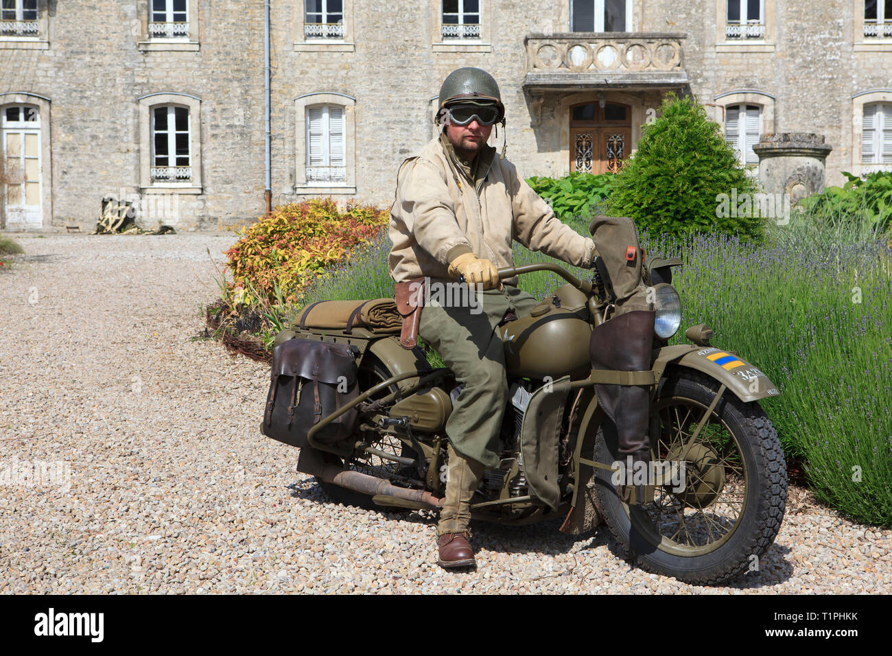 A private of the 101st Airborne Divison of the US army on a Liberator Harley Davidson motorcyle during the D-Day celebrations in Normandy, France - Stock Image