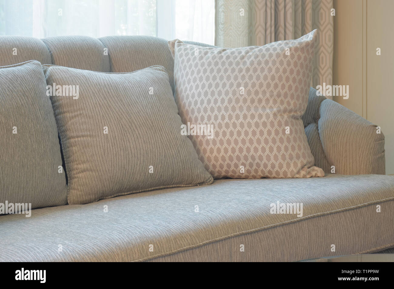 Comfy sofa with pillows in living room - Stock Image
