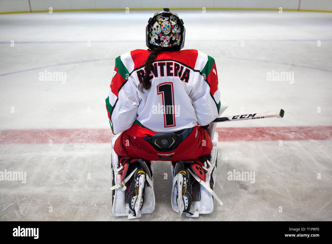 Mónica Evangelina Renteria Peñafort, 31, one of the goalkeepers of the Selección femenil de México de hockey sobre hielo, after a training session over the course of a 3-day intensive training week-end at the Winter Sports Center Metepec in Metepec, State of Mexico, Mexico on March 9, 2019. Mónica had her helmet customized in Canada with skulls reminiscent of the traditional Day of the Dead festival in Mexico. Mónica lives in Campestre Churubusco neighborhood in Mexico City, with her family. She studied gastronomy and culinary art. She is now a coach to goalkeepers at different ice hockey club Stock Photo