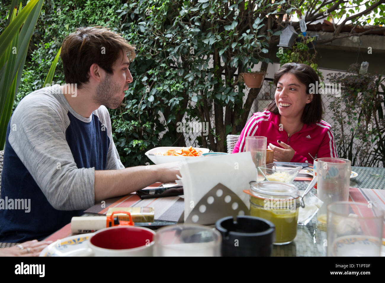 Macarena Cruz Ceballos (R), 23, one of the defenders of the Selección femenil de México de hockey sobre hielo, eats breakfast with her family and boyfriend at her home in Mexico City, Mexico on March 17, 2019. Macarena lives with her parents in San Jerónimo Lídice, an affluent residential neighborhood in Mexico City. Her brother lives in Canada, where he plays ice hockey in the Junior League. She studies economics and finance at the Monterrey Institute of Technology, at the Mexico City campus. She started figure skating at age 5 and ice hockey at age 12. She is one of the assistant captains of Stock Photo