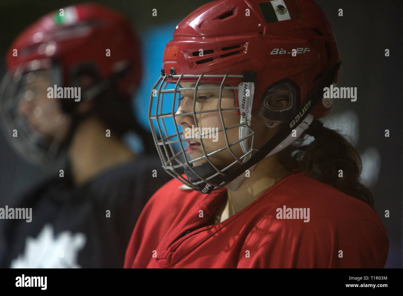 Samantha Nevarez Puente (R), 16, one of the forwards of the Selección femenil de México de hockey sobre hielo, during a training session at the San Jerónimo ice rink in Mexico City, Mexico on October 2, 2018. The team have trainings every Tuesday and Thursday from 10.30 pm to midnight. Twenty five women and girls from the ages of 16 to 34 train to be drafted in the 19 – strong team that will go to the 2019 IIHF Women's World Championship Division II in Scotland in April 2019. Founded in 2012, the Selección femenil de México de hockey sobre hielo is the first and only women's national ice hocke Stock Photo