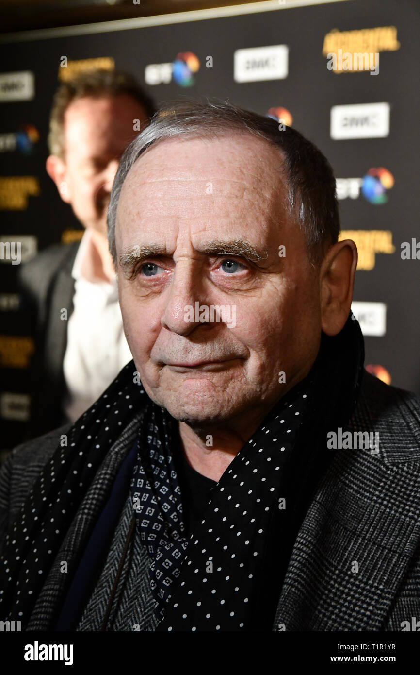 London, UK. 27th Mar 2019. Sylvester McCoy arrives at Premiere of documentary about the British film production company, Handmade Films, created by George Harrison of the Beatles on 27 March 2019, London, UK. Credit: Picture Capital/Alamy Live News - Stock Image