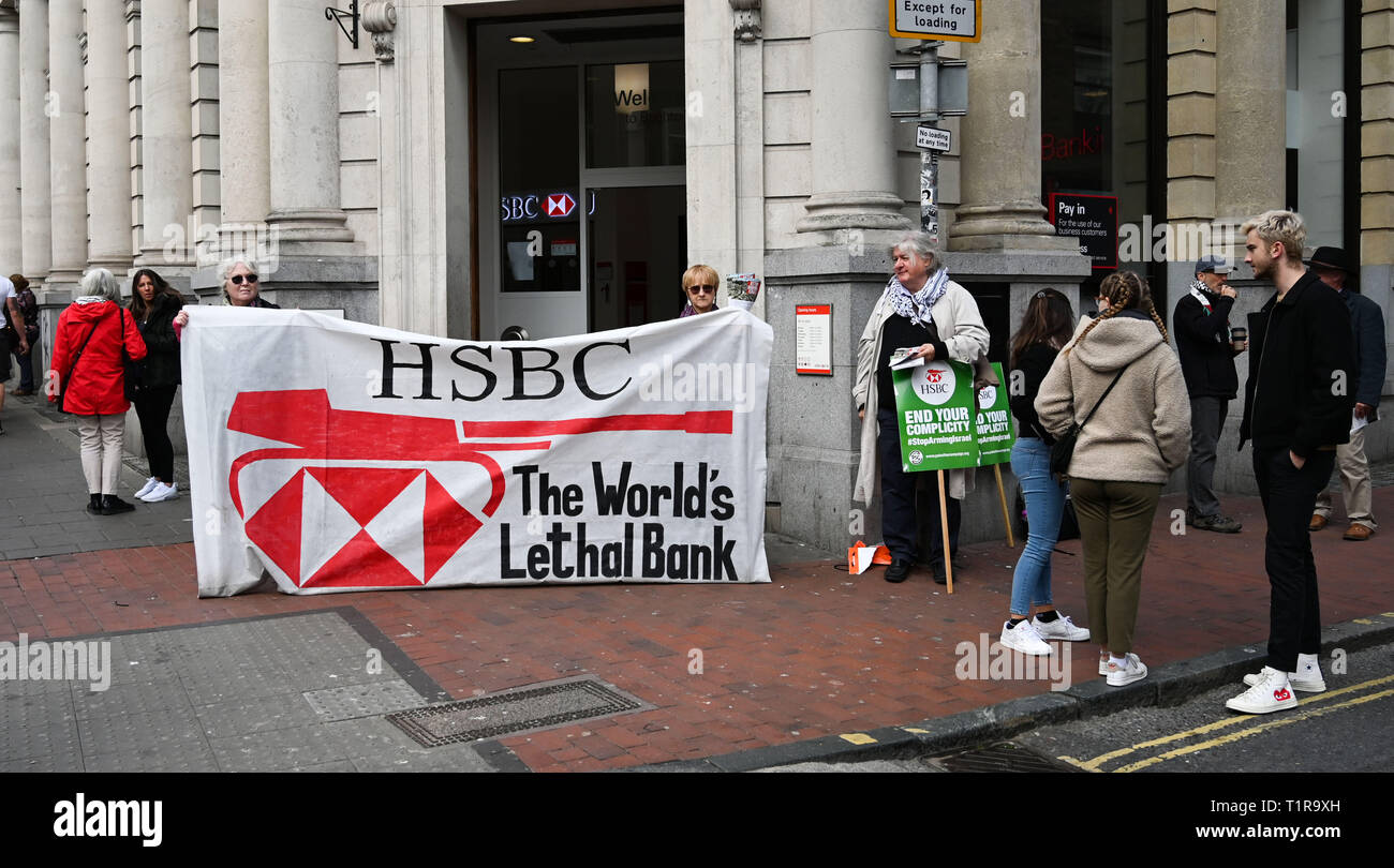 Brighton, UK. 28th Mar, 2019. The Brighton and Hove Palestine Solidarity Campaign outside the HSBC bank in North Street Brighton today . The Stop Arming Israel campaign is hoping to put pressure on the bank to cut ties with companies allegedly supplying weapons to Israel Credit: Simon Dack/Alamy Live News - Stock Image