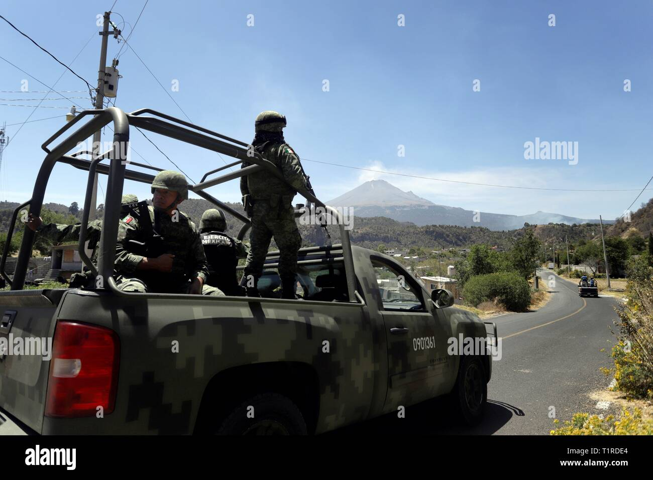 Xalitzintla, Mexico. 28th Mar, 2019. Members of the Mexican Army patrol near the Popocatepetl volcano, in Xalitzintla, Mexico, 28 March 2019. The National Civil Protection Office of Mexico elevated the phase three alert to yellow due to the activity of the Popocatepetl volcano. EFE/ Hilda Rios Credit: EFE News Agency/Alamy Live News Stock Photo