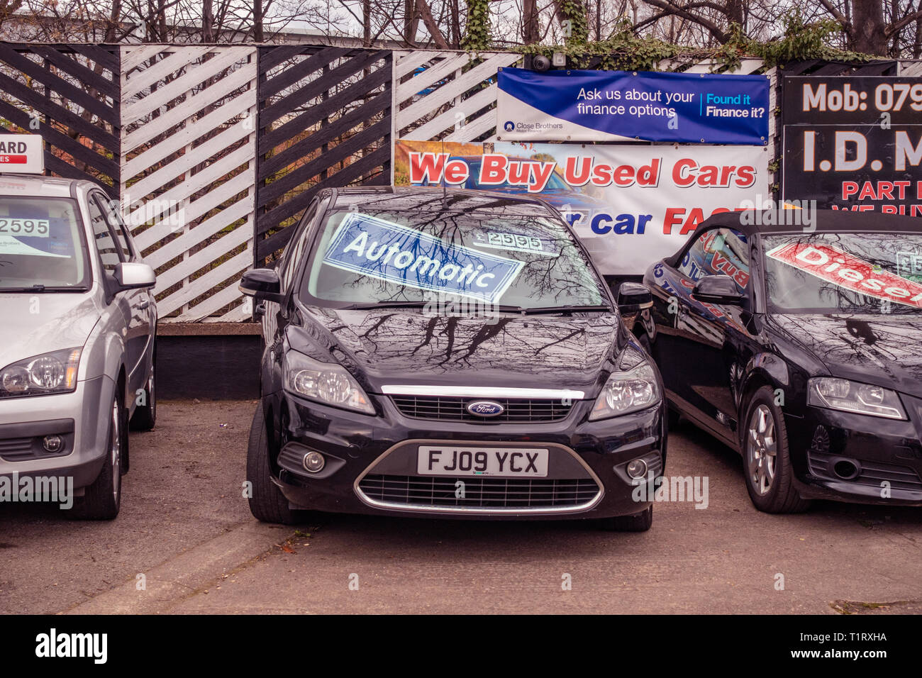 General view from the street of a Used Car Sale forecourt on a Second Hand Car sales pitch at the side of the road - Stock Image