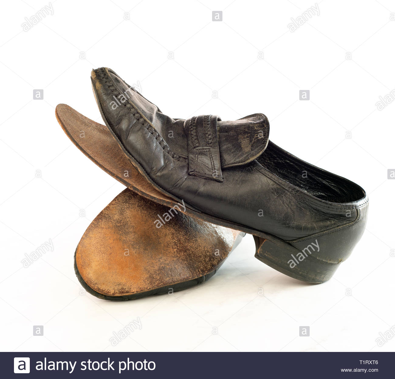 Old pair of Mens leather black dress shoes that are worn out, very dusty and dirty and falling apart.  They need polish and repair - Stock Image