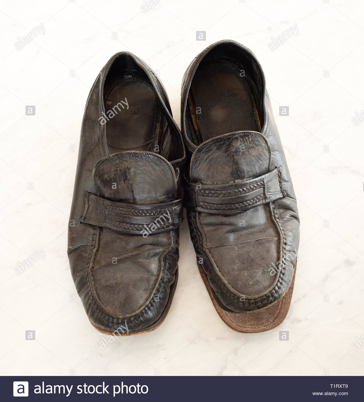 3be4b466 Old pair of Mens leather black dress shoes that are worn out, very dusty  and dirty and falling apart. They need polish and repair