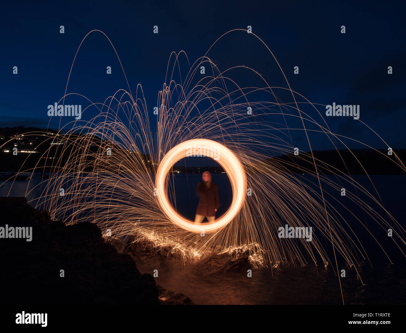 A steel wool shot on Splat Cove in Devon. Steel wool photography involves using a whisk,steel wool and a dog lead. Stock Photo