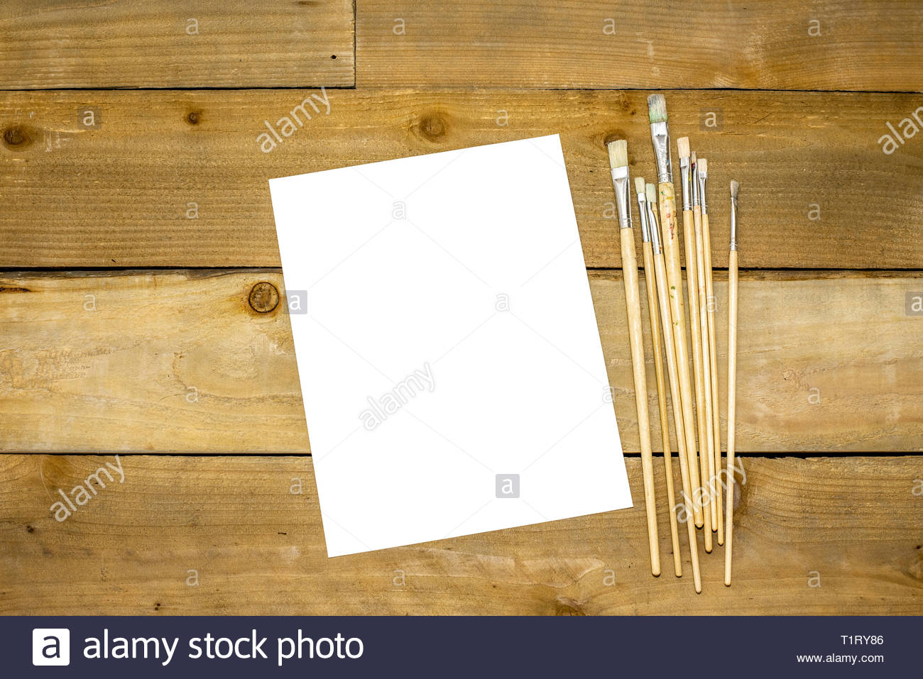 Paint brushes on a rustic distressed wooden background Stock Photo