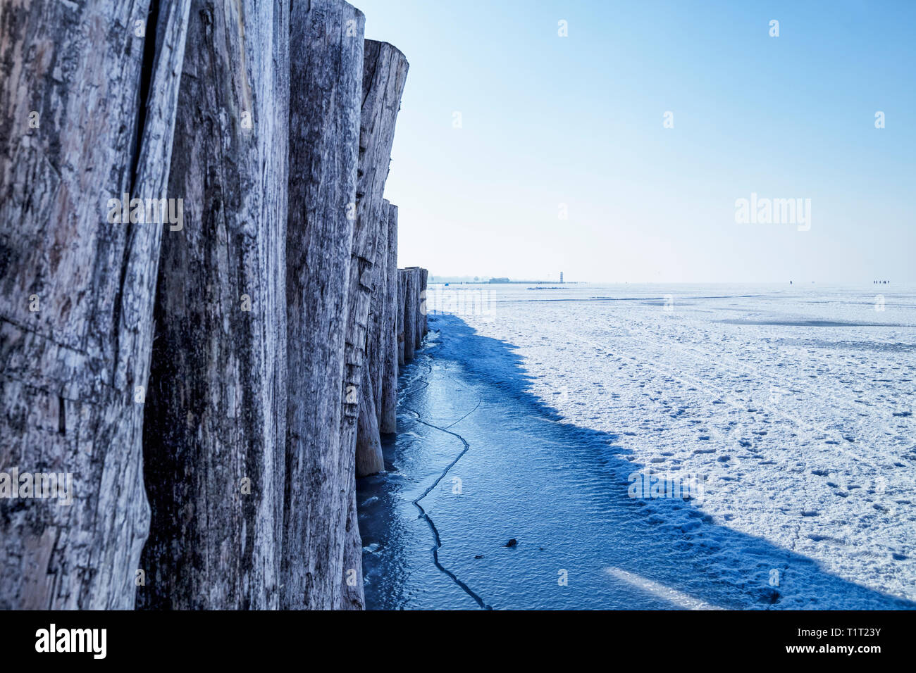 Wooden planks on frozen lake - Stock Image