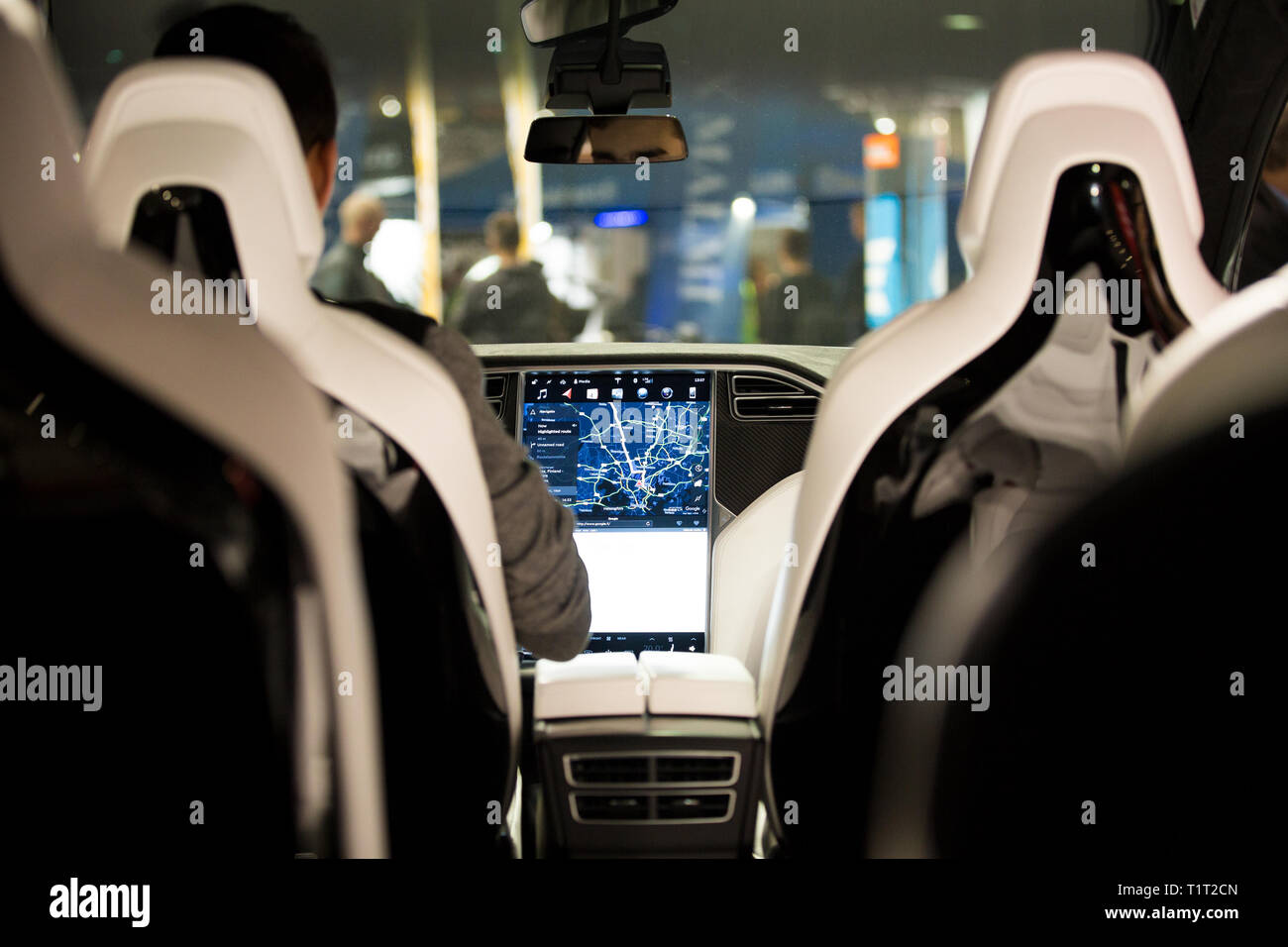HELSINKI, FINLAND - NOVEMBER 04, 2016: The interior of a Tesla Model X electric car with large touch screen dashboard.  Seats. - Stock Image