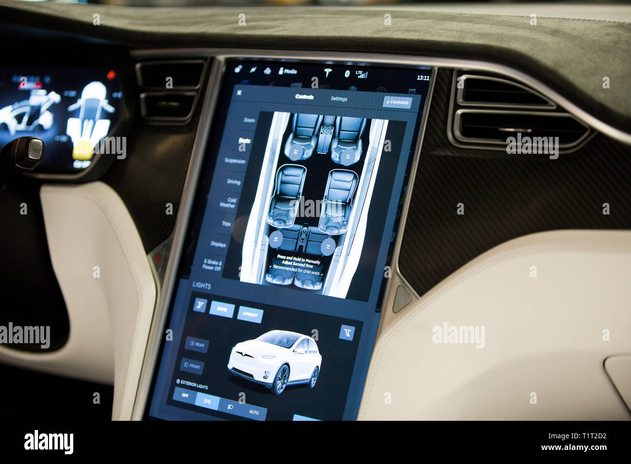 HELSINKI, FINLAND - NOVEMBER 04, 2016: The interior of a Tesla Model X electric car with large touch screen dashboard.  remote control. - Stock Image