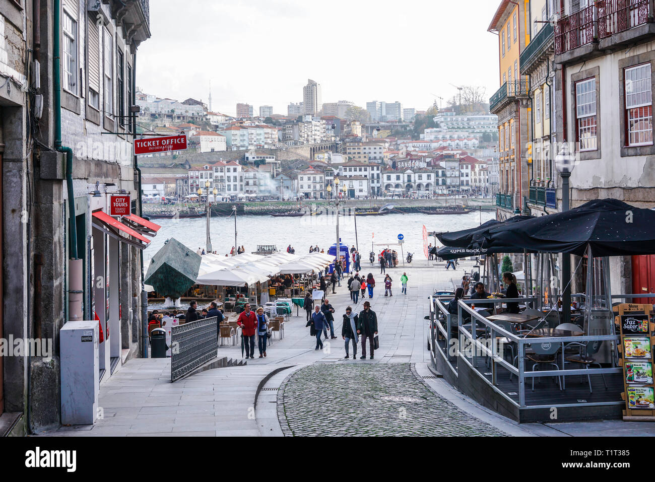 Porto, Portugal - December 2018: Ribeira Square during the day, with people walking and view to Douro River. Stock Photo
