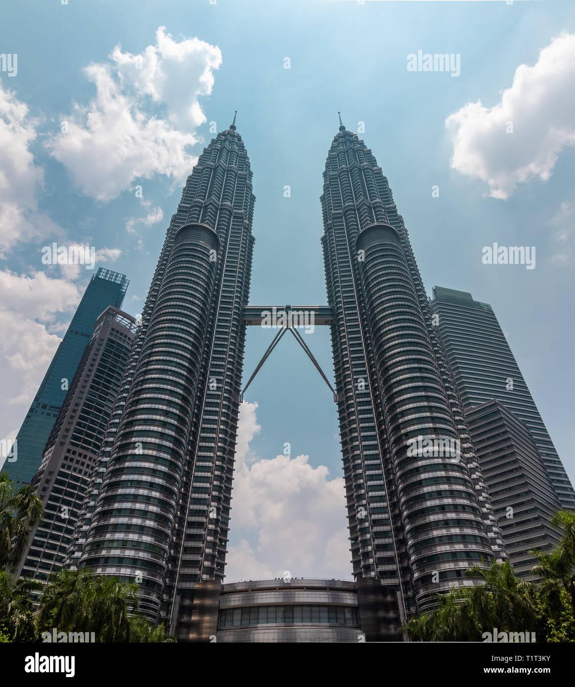Petronas Towers in Kuala Lumpur, Malaysia. World's largest skyscraper before the opening of Burj Khalifa. - Stock Image