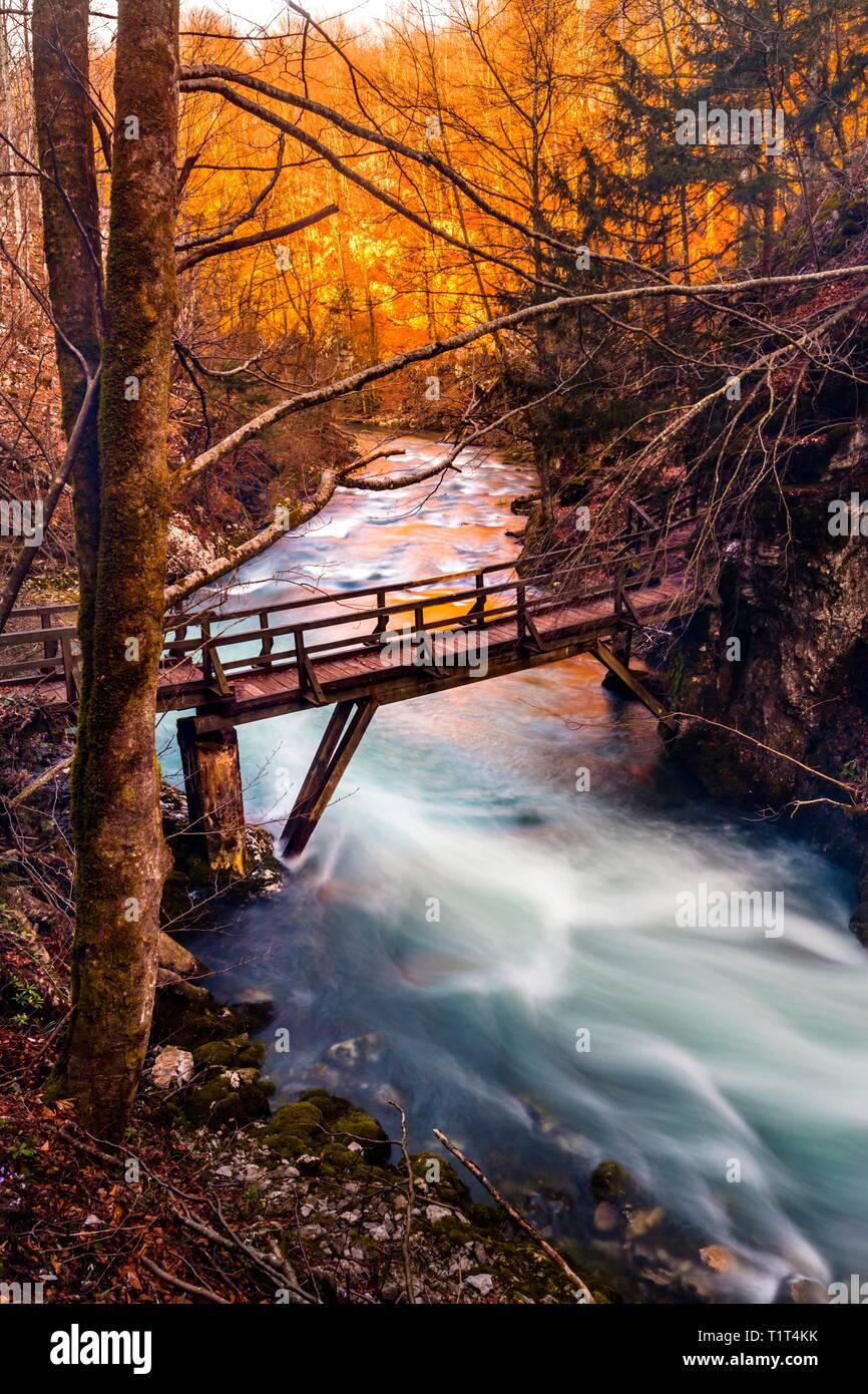 Autumn colors in nature wooden footbridge foot-bridge in Kamacnik near Skrad in Croatia apparently almost evidently - Stock Image
