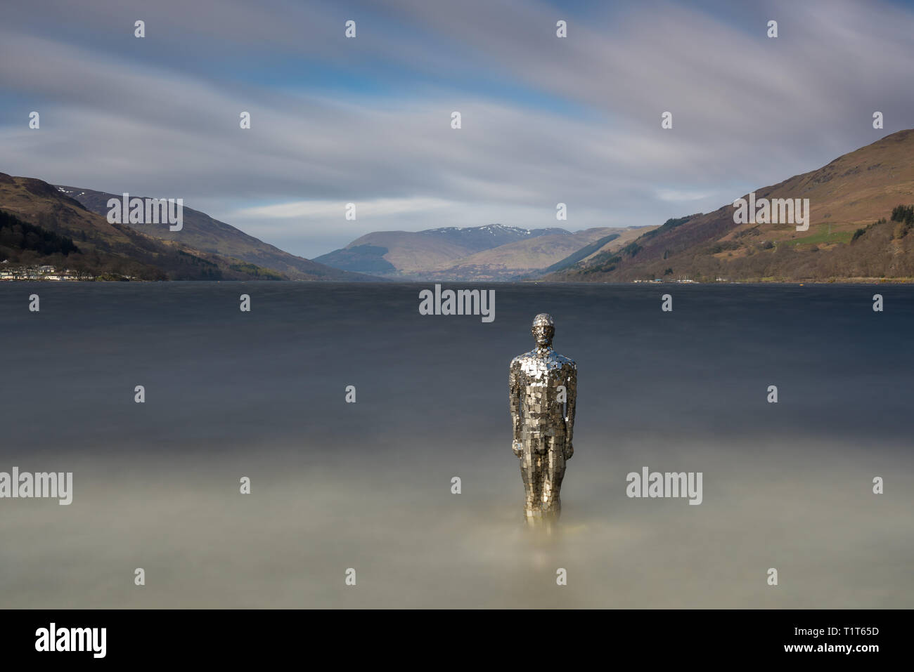 The famous mirror man sculpture that sits in Loch Earn, Perth and Kinross, Scotland - Stock Image