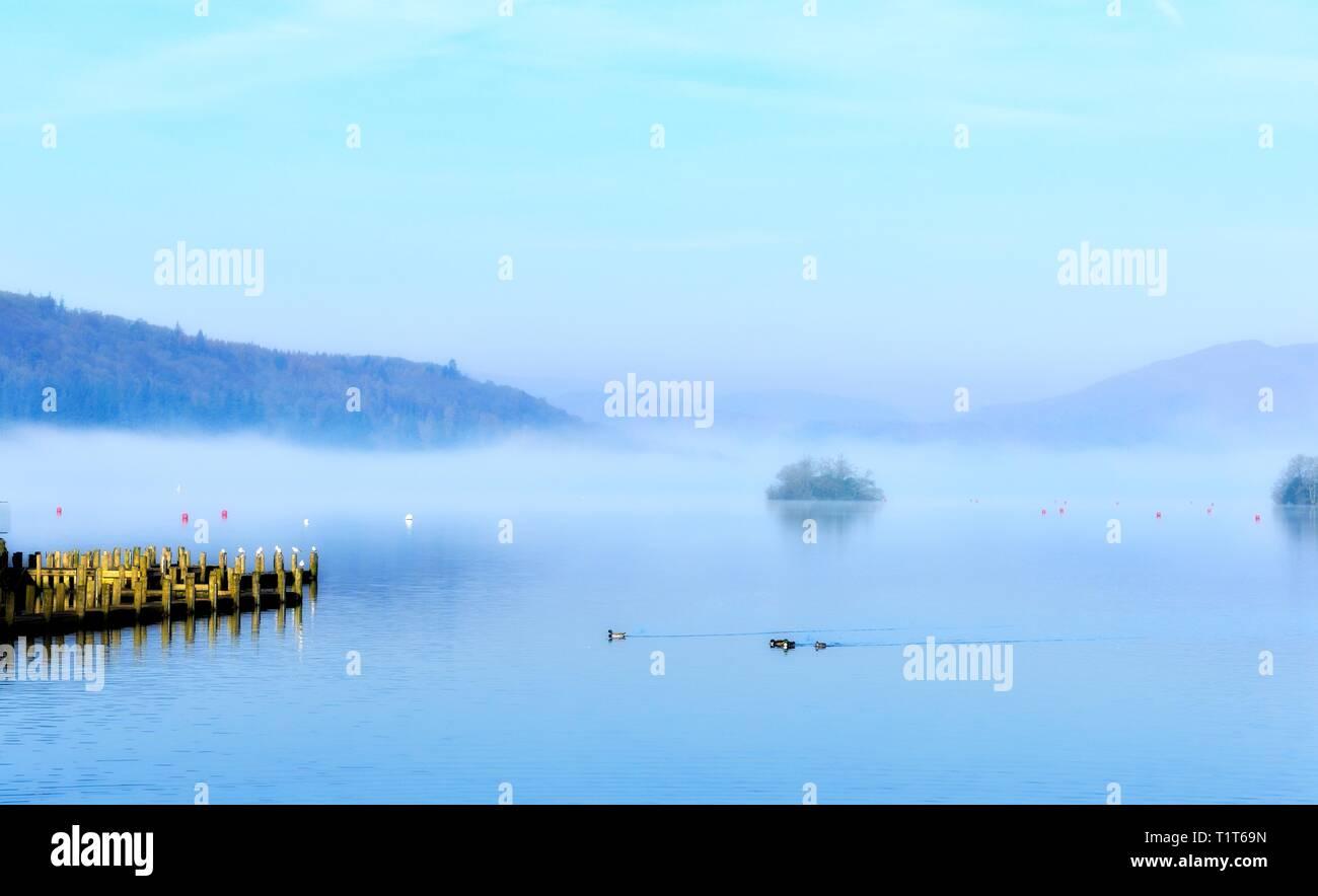 Mist morning on Lake Windermere, Bowness on  Windermere,Lake District,Cumbria,England,UK Stock Photo