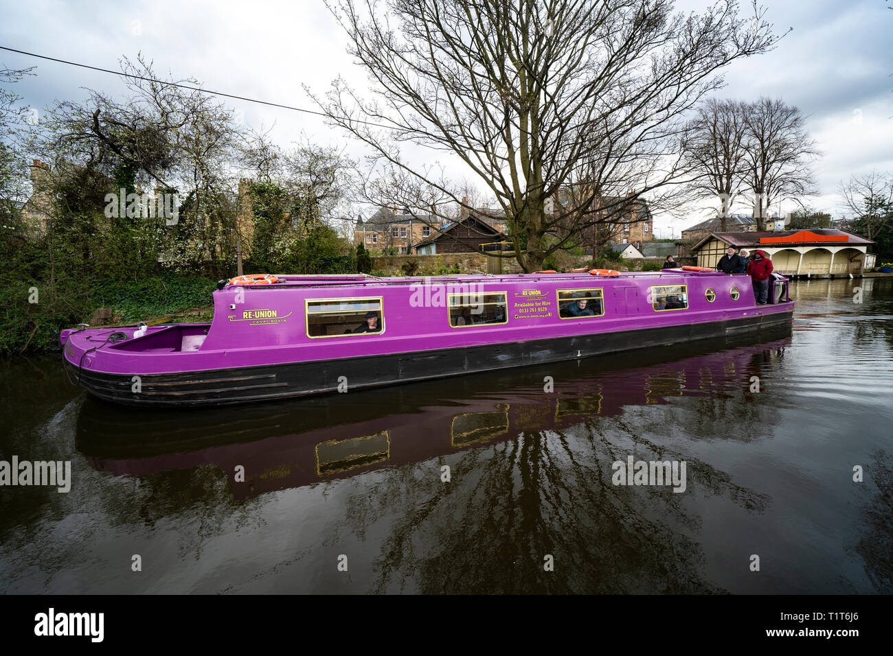 The Union Canal with narrowboat in early spring  in Edinburgh, Scotland, UK - Stock Image
