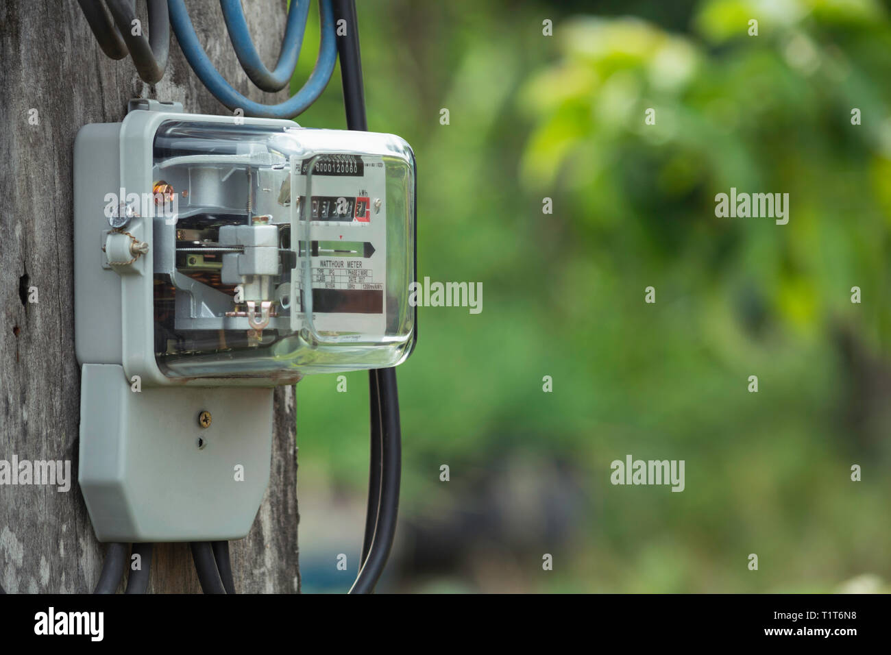 Electric power meter measuring power usage. Watt hour electric meter measurement tool with copy space. - Stock Image