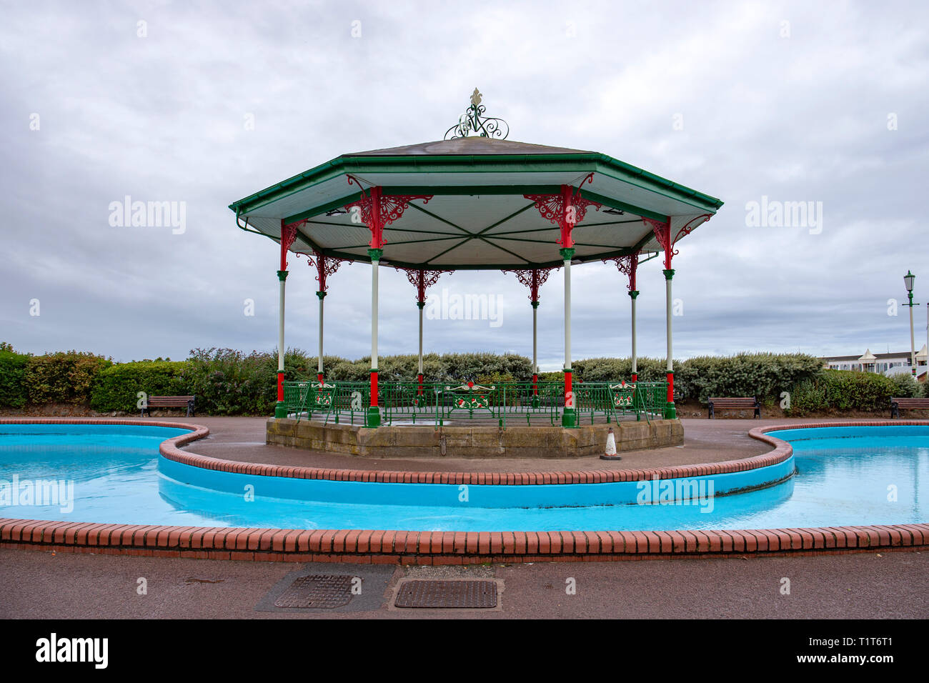 Paddling pool with bandstand on the promenade in Lytham St Annes Lancashire UK - Stock Image